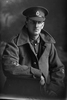 3/4 portrait of Private Archibald Haresnape, Reg no. 3/3430, New Zealand Medical Corps, wearing greatcoat (Photographer: Herman Schmidt, 1918). Sir George Grey Special Collections, Auckland Libraries, 31-H3737. No known copyright.