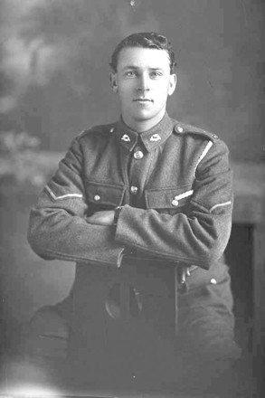 3/4 portrait of Lance Corporal Lupton of the 17th Reinforcements. Probably (Corporal in the nominal Rolls) Henry Lupton, Reg No 26869, of the Auckland Infantry Battalion, - A Company. (Photographer: Herman Schmidt, 1916). Sir George Grey Special Collections, Auckland Libraries, 31-L1724. No known copyright.
