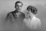 3/4 group portrait of Chaplain Captain Leslie Bourneman Neale, Reg No 35569, of the Chaplain Corps, and a woman, probably his wife Mary. (Photographer: Herman Schmidt, 1917). Sir George Grey Special Collections, Auckland Libraries, 31-N2890. No known copyright.