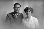 3/4 group portrait of Chaplain Captain Leslie Bourneman Neale, Reg No 35569, of the Chaplain Corps, and a woman, probably his wife Mary. (Photographer: Herman Schmidt, 1917). Sir George Grey Special Collections, Auckland Libraries, 31-N4500. No known copyright.