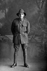 Full length portrait of Rifleman Olds of the New Zealand Rifle Brigade, possibly Harold Olds, Reg No 46478, J Company. Killed in action in France on 12 October 1917 at the Battle of Passchendaele. (Photographer: Herman Schmidt, 1917). Sir George Grey Special Collections, Auckland Libraries, 31-O4534. No known copyright.