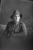 3/4 portrait of Rifleman Olds of the New Zealand Rifle Brigade, possibly Harold Olds, Reg No 46478, J Company. Killed in action in France on 12 October 1917 at the Battle of Passchendaele. (Photographer: Herman Schmidt, 1917). Sir George Grey Special Collections, Auckland Libraries, 31-O4535. No known copyright.