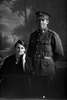 3/4 portrait of Private Ryan of the 14th Reinforcements, A Company, and a woman. Possibly Percy Joseph Ryan, Reg No 14486, and his wife Phoebe Violet Lily Ryan. (Photographer: Herman Schmidt, 1916). Sir George Grey Special Collections, Auckland Libraries, 31-R2097. No known copyright.