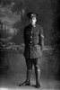 Full length portrait of Lance Sergeant Harry Ernest Reynolds, Reg No 49115, of the Auckland Infantry Regiment, - A Company, 27th Reinforcements. (Photographer: Herman Schmidt, 1917). Sir George Grey Special Collections, Auckland Libraries, 31-R3231. No known copyright.