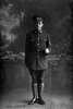 Full length portrait of Lance Sergeant Harry Ernest Reynolds, Reg No 49115, of the Auckland Infantry Regiment, - A Company, 27th Reinforcements. (Photographer: Herman Schmidt, 1917). Sir George Grey Special Collections, Auckland Libraries, 31-R3232. No known copyright.