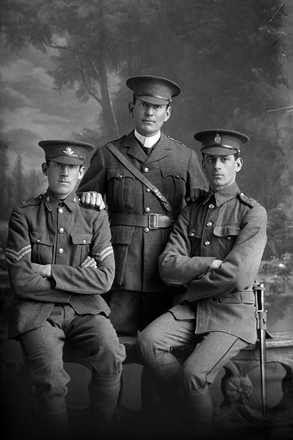 3/4 portrait of 3 men including Captain James Arthur Shand, Reg No 12/4304, of the Auckland Infantry Regiment, A Company, 11th Reinforcements, and a corporal with the 6th (Hauraki) Regiment, Auckland Infantry Regiment, and a private with the New Zealand Railway Corps. (Photographer: Herman Schmidt, 1916). Sir George Grey Special Collections, Auckland Libraries, 31-S1024. No known copyright.