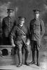 Full length portrait of 3 men including Captain James Arthur Shand, Reg No 12/4304, of the Auckland Infantry Regiment, A Company, 11th Reinforcements, and a corporal with the 6th (Hauraki) Regiment, Auckland Infantry Regiment, and a private with the New Zealand Railway Corps. (Photographer: Herman Schmidt, 1916). Sir George Grey Special Collections, Auckland Libraries, 31-S1025. No known copyright.