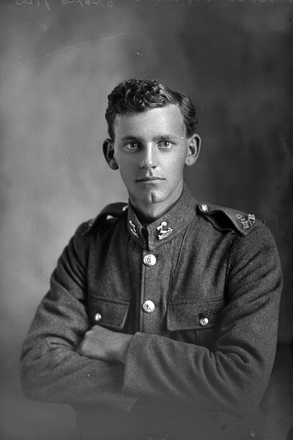 1/4 portrait of Private Basil Conran Smith, Reg No 12/3823, of the 3rd (Auckland) Regiment, Auckland Infantry Battalion, - A Company, 9th Reinforcements. (Photographer: Herman Schmidt, 1915|1916). Sir George Grey Special Collections, Auckland Libraries, 31-S1070. No known copyright.