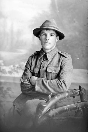 3/4 portrait of Trooper John Francis Turnwald, Reg No 13/1103, with the 3rd (Auckland) Mounted Rifles, Auckland Mounted Rifles, New Zealand Mounted Rifles, later with the Imperial Camel Corps. Died of wounds in Palestine on 6 June 1917. (Photographer: Herman Schmidt, 1915). Sir George Grey Special Collections, Auckland Libraries, 31-T1242. No known copyright.