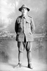 Full length portrait of Trooper John Francis Turnwald, Reg No 13/1103, with the 3rd (Auckland) Mounted Rifles, Auckland Mounted Rifles, New Zealand Mounted Rifles, later with the Imperial Camel Corps. Died of wounds in Palestine on 6 June 1917. (Photographer: Herman Schmidt, 1915). Sir George Grey Special Collections, Auckland Libraries, 31-T1244. No known copyright.