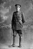 Full length portrait of 2nd Lieutenant Norman Russell Withiel Thomas, Reg No 20940, of the 24th Reinforcements, - E Company, with collar badges of the New Zealand Signal Corps. (Photographer: Herman Schmidt, 1917). Sir George Grey Special Collections, Auckland Libraries, 31-T3278. No known copyright.