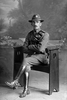 Full length portrait of Trooper Walter Workman, Reg No 13/2968, of the Auckland Mounted Rifles, - A Squadron, New Zealand Mounted Rifles. (Photographer: Herman Schmidt, 1916). Sir George Grey Special Collections, Auckland Libraries, 31-W1421. No known copyright.