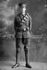 Full length portrait of either Trooper Albert Sydney Wyllie, Reg No 13/2631, or his brother Herbert Wills Wyllie, Reg No 13/2632, both of the 3rd (Auckland) Mounted Rifles, Auckland Mounted Rifles, New Zealand Mounted Rifles, 8th Reinforcements. (Photographer: Herman Schmidt, 1915). Sir George Grey Special Collections, Auckland Libraries, 31-W1783. No known copyright.