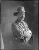 3/4 length portrait of Colonel James Neil McCarroll, with a moustache, seated, wearing the uniform of the 11th North Auckland Mounted Rifles, campaign medals (Photographer: Herman Schmidt, ). Sir George Grey Special Collections, Auckland Libraries, 31-WP881. No known copyright.