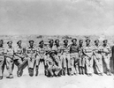 Informal group photo of 14 soldiers during WWII, including Darcy Gardiner, s/n 800706 at extreme right of photo. (Collection of Darcy Gardiner (800706)) . Image provided by Brian Gardiner. This image may be subject to copyright.