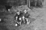 Ron (l) and Gordon with cat outside a tent. (Collection of Darcy Gardiner (800706)) . Image provided by Brian Gardiner. This image may be subject to copyright.