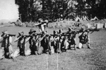 9 members of the Bren Carrier platoon practising shooting their rifles at camp. (Collection of Darcy Gardiner (800706)). Image provided by Brian Gardiner. This image may be subject to copyright.