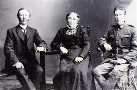 """Family portrait of Lugg family. """"Stanley James Lugg, with his parents Bill and Anne Lugg, presumably before he left NZ for Suez 1915"""". Image provided by family.  Image has no known copyright restrictions."""