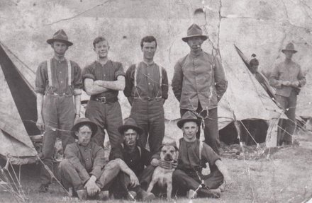 Group portrait of WWI soldiers in unknown Camp. Alfred Shakeshaft is sitting on the far right with arm around dog. Image provided by Arthur Jones (2015). Image has no known copyright.