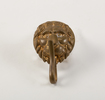 hat badge: brass lions head with clip : used to tu...