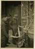 Street portrait of unidentified soldier, Geoff Wake and Andrew Todd looking at a street vendor's offerings while on leave in Florence, Italy. Image provided by Sally Chao. This image may be subject to copyright.