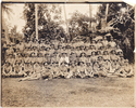 Photograph of the Auckland Section of Samoan Relief Force taken July 1915. Officers in front row (seated) left to right; RC Smith (s/n 19/256); C Mackie (s/n 5/202); AF Miller (s/n 19/189); Chaplain G Wells-Smailes (19/2131). Photograph taken by Tattersalls studios, Apia, Samoa. Image provided by Nick Warner Smith. Image has no known copyright restrictions.