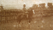 On horseback, Edmund Graham Baskett with the Nigerian troop, photo from his personal album. Image kindly provided by Sally Chao April 2016. Image has no known copyright restrictions.