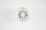 white ashtray with blue petal pattern in centre of...