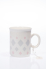 Mug with slightly flared lip, cream coloured with ...