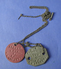 Id tags on chain, belonging to 812003 L.Cpl Esme B...