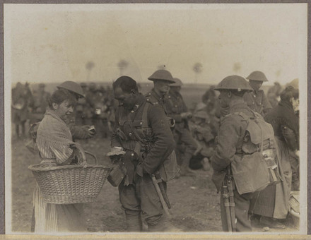 Unknown photographer (1917) A Maori buys cakes from vendor whilst halting [William Marsters]. Auckland War Memorial Museum - Tamaki Paenga Hira. PH-ALB-418 H32. Image has no known copyright restrictions.