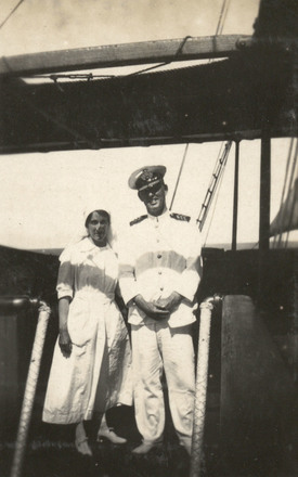 22/74 Nurse Eleanor Gould with Captain Williams of the HMT Tofua. Photograph Album collated by 22/74 Sister Mary Eleanor Gould, New Zealand Army Nursing Service Corps. The album covers Sister Gould's time in Egypt on the Marquette, HS Gascon, HS Glengorm Castle and in England. National Army Museum of New Zealand. 1986.1753_A01_048_12992-468. CC BY 3.0.