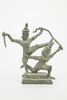 metal statuette of two dancing figures on a two ti...