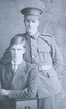 Photograph of Private John Joseph Carroll 26555 (back standing) and Private Terence Carroll 76342 (front seated). Image kindly provided by Dorothy Giles (November 2017). Image has no known copyright restrictions.