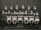 Group portrait of the Auckland Grammar School 1st XI Hockey team with John Bremner seated far left as coach. Auckland Grammar School Chronicle, XLIII, 1955. Image is subject to copyright restrictions.