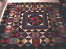 patchwork quilt, triangles and squares of material...