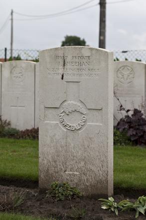 Headstone of Private John Sheehan (11957). Haringhe (Bandaghem) Military Cemetery, Poperinge, West-Vlaanderen, Belgium. New Zealand War Graves Trust (BEBP2178). CC BY-NC-ND 4.0.
