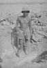 Photograph of Eric Batchelor 'Digging in'. 'He is proud of that hole'. Western Desert, c. Second World War. From the collection of Arthur William (Moss) Squire 16770, 23 Battalion. Image kindly provided by Roger Sommerville (October 2019). Image may be subject to copyright restrictions.