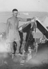 Photograph of Eric Batchelor at the tent he shared with Arthur 'Moss' Squire at 'Kaponga', Egypt, probably in August 1941. From the collection of Arthur William (Moss) Squire 16770, 23 Battalion. Image kindly provided by Roger Sommerville (October 2019). Image may be subject to copyright restrictions.