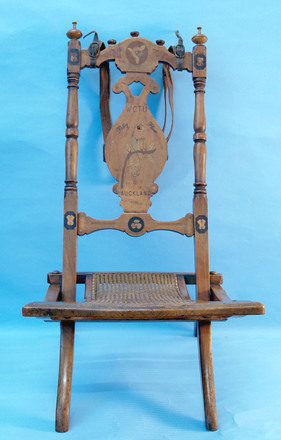 """Folding chair dedicated to MC """"Polly Plum"""" and WCTU, Auckland [2006.98.2]"""