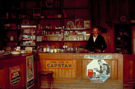 Ted Duggan's Store, Matakanui. I'd taken Ted's photo the year before for a magazine.  In this picture, taken from the same angle, he is looking for it.