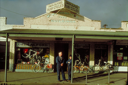 Owen Alford's Ruby Cycles, Rangiora. Mrs M. E. Thompson's Buildings are soon to be demolished to make way for new council chambers.