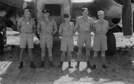 A group photograph of a RNZAF 9 Squadron Ventura crew, taken at Bougainville, 2 February 1945. F/sgt Piripi (Kena) RAKENA NZ436618 mid upper gunner, W/off Leonard DUNWOODY radio operator, P/off Bruce REID pilot, P/off Roy Bradney BOULD NZ2312 navigator/bomb aimer, Sgt Donald PRYOR tail gunner. No known copyright restrictions.