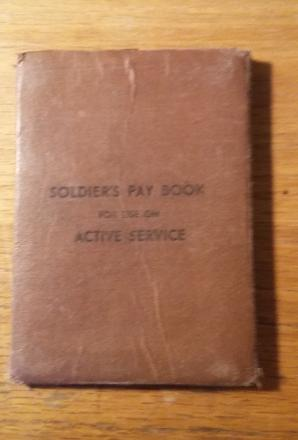 "A small brown paperback book. Entitled in block letters - ""SOLDIERS PAY BOOK for use on ACTIVE SERVICE"""