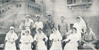 The staff of Aotea Convalescent Home, Heliopolis, Cairo. Back, from left: Sister M McDonald, gunner, John Stuart NZFA, Captain R Gerrard, Sergeant G Sleight and Sister L McLaren. Front, from left: Sisters R Cameron, N Hughes and M McDonnel, Matron M Early, Sister B McDonald and Sister K Booth.  - No known copyright restrictions.