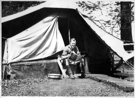 Hugh Percy (AKA Buzzer) reading 'Punch Magazine' Outside Tent On Norfolk Island 1943