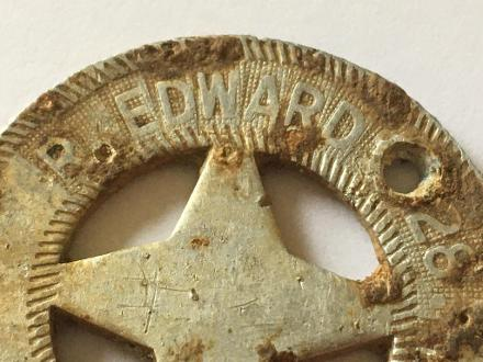 """Metal detectorist Mark Davison unearthed this 28th Maori Battalion badge of R. Edwards 28th Maori Battalion in a field at Harewarren Farm, Chalk Lane, Dogmersfield, Hampshire, England, on October 20, 2019, along with another general issue NZ military badge inscribed """"New Zealand Forces""""."""