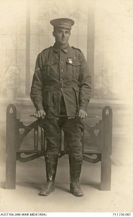 Studio portrait of Lance Sergeant [Lance Corporal] Harvey Stanley Hyde Blackburn, wearing a medal.  Photo held in the archives of the Australian War Memorial.