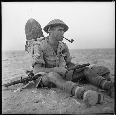 Reference Number: DA-02581-F  New Zealand World War 2 soldier Sergeant Ian Thomas of 25 Battalion, Egypt. Photograph taken by W A Whitlock.Note on back of file print reads: Taken at 7.30 pm on start line of attack by 6 Brigade...NOT at final battle at El Alamein.
