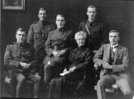 Studio portrait of the Aekins family: Leonard Aekins (s/n 10/3167), Percy Aekins, Kenneth Aekins (s/n 1/321), Margaret Aekins (belived to be the mother of the five Aekin boys, Hector Aekins (s/n 41212), and William Aekins (s/n 9484, Boer war)